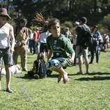 Cecilia Lanir, age 7, jumps rope with the help of Heather World (left) during Hardly Strictly Bluegrass in Golden Gate Park in San Francisco, Calf., on Saturday, October 6, 2012.