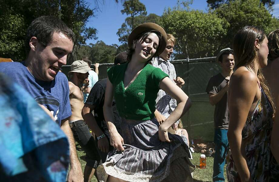 Courtney Russell (center) dances to the music of the Alison Brown Quartet at the Banjo Stage during Hardly Strictly Bluegrass in Golden Gate Park in San Francisco, Calf., on Saturday, October 6, 2012. Photo: Laura Morton, Special To The Chronicle