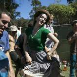 Courtney Russell (center) dances to the music of the Alison Brown Quartet at the Banjo Stage during Hardly Strictly Bluegrass in Golden Gate Park in San Francisco, Calf., on Saturday, October 6, 2012.
