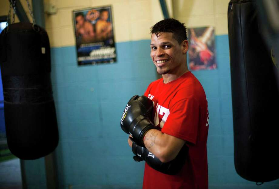 Orlando Cruz, a 31-year-old featherweight, isn't the first boxer or athlete to come out as openly gay, but it's rare for an athlete to come out mid-career. Dennis M. Rivera Pichardo/Associated Press Photo: Dennis M. Rivera Pichardo, Associated Press / AP