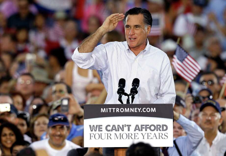 Republican Presidential candidate and former Massachusetts Gov. Mitt Romney salutes to the crowd during a campaign speech Friday, Oct. 5, 2012, in St. Petersburg, Fla. (AP Photo/Chris O'Meara) Photo: Chris O'Meara / AP