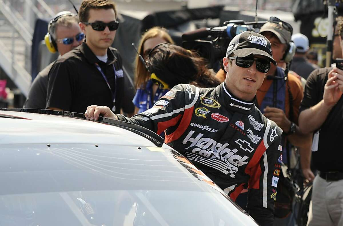 NASCAR driver Kasey Kahne climbs out of his car after his qualifying attempt at the Talladega Superspeedway in Talladega, Ala., Saturday, Oct. 6, 2012. Kahne took to the pole with a speed of 191.455 mph. (AP Photo/Dan Lighton)