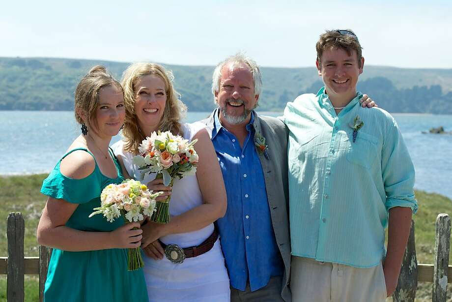 Winemaker Susan Lueker and bistro owner Ralph Tingle are flanked by Ralph's kids, Mollie Tingle (left) and Reilly Tingle, at their wedding and reception at Hog Island Oyster Farm. Photo: Ericleephotographer.com, Agency