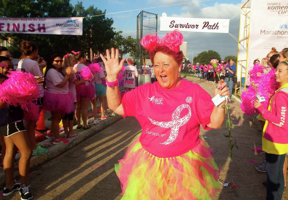 Five-year cancer survivor Verna Hicks celebrates at the finish line Saturday at the Komen Race for the Cure on Allen Parkway. Photo: Cody Duty / © 2012 Houston Chronicle