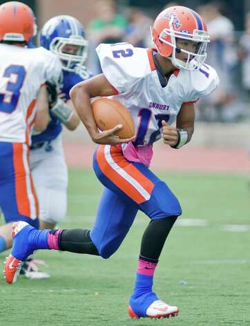 Danbury High School quarterback Anfreny Ith carries the ball against Darien High School in a football game at Darien. Saturday, Oct. 6, 2012 Photo: Scott Mullin / The News-Times Freelance