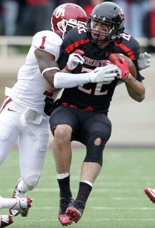 Texas Tech's Jace Amaro is hit by Oklahoma's Tony Jefferson during an NCAA college football game in Lubbock, Texas, Saturday, Oct. 6, 2012. (AP Photo/Lubbock Avalanche-Journal, Scott MacWatters) LOCAL TV OUT Photo: Scott MacWatters, Associated Press / Lubbock Avalanche-Journal