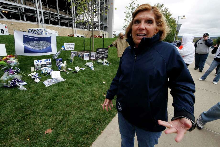 Gayle Barnes, a member of the jury that convicted former Penn State assistant football coach Jerry Sandusky, stands outside Beaver Stadium on Saturday, Oct. 6, 2012 in State College, Pa.  Jerry Sandusky should be sent to prison for life when a judge sentences him Tuesday, according to several of the jurors who convicted the former Penn State assistant coach of molesting several boys over a period of years. Barnes, a homemaker and former school district employee, said she thinks a lot about the victims, particularly the eight who testified against Sandusky and provided what she considers the critical evidence of guilt. She said he deserves life in prison. (AP Photo/Gene J. Puskar) Photo: Gene J. Puskar / AP