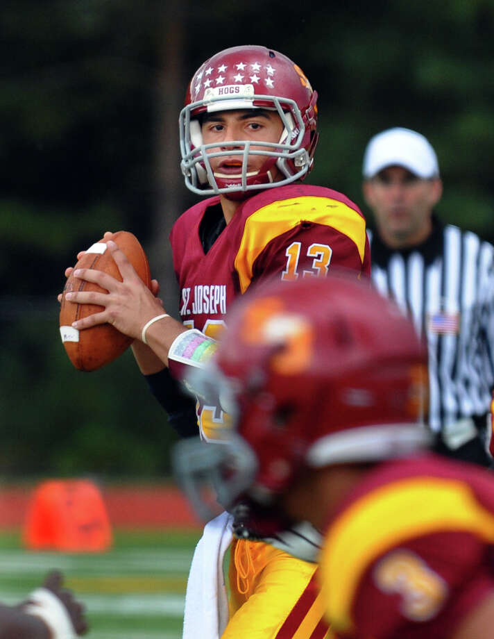 St. Joseph QB Jordan Vazzano prepares to throw a pass, during boys football action against Stamford in Trumbull, Conn. on Saturday October 6, 2012. Photo: Christian Abraham / Connecticut Post