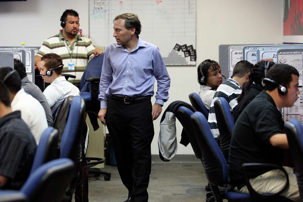 Global Telesourcing's President Bill Colton, checks out daily activity at the company's site in Monterrey, Mexico, The U.S.-owned telemarketing company hires workers thighly skilled in English returning to Mexico.