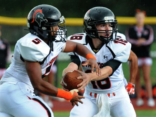 Stamford QB Tyler Kane hands off the ball to #5 Cameron Webb, during boys football action against St. Joseph in Trumbull, Conn. on Saturday October 6, 2012. Photo: Christian Abraham / Connecticut Post