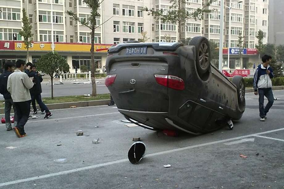 Tension last month at another Chinese factory that makes iPhones led to a brawl that overturned a car. Photo: Associated Press