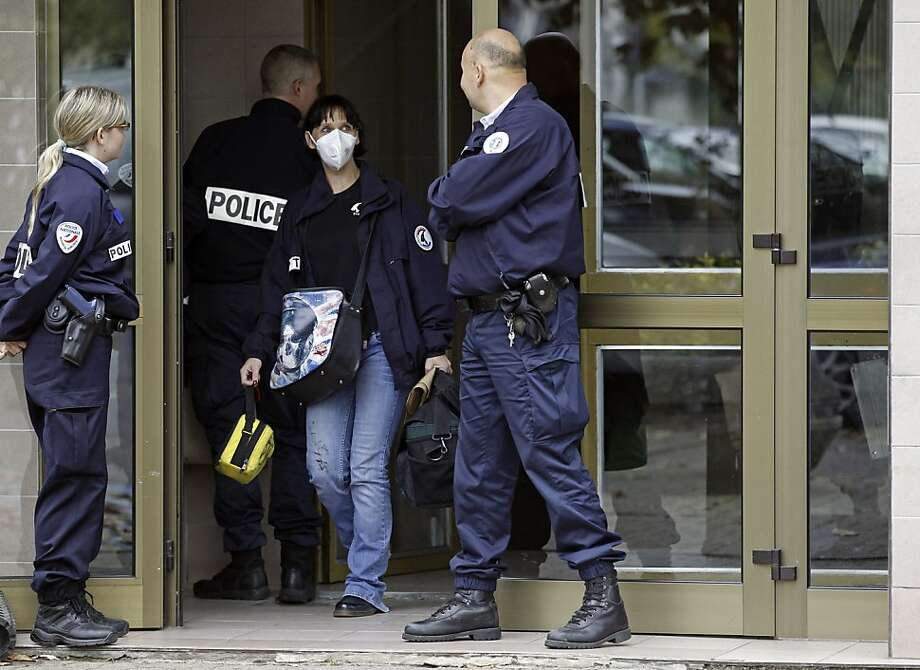 French police guard a building where a suspected jihadist was shot and killed during a raid. Photo: Jean Francois Badias, Associated Press