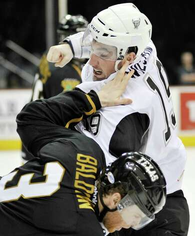 San Antonio Rampage's Garrett Wilson, top, punches Texas Stars' Gord Baldwin during the second period of an AHL hockey game, Friday, Jan. 25, 2013, in San Antonio. Photo: Darren Abate, Darren Abate/pressphotointl.com / Darren Abate/pressphotointl.com