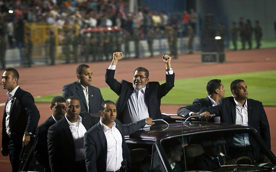 Egyptian President Mohammed Morsi arrives at a stadium during a national holiday marking the 1973 war with Israel. Morsi has faced criticism unheard of before last year's uprising. Photo: Khalil Hamra, Associated Press