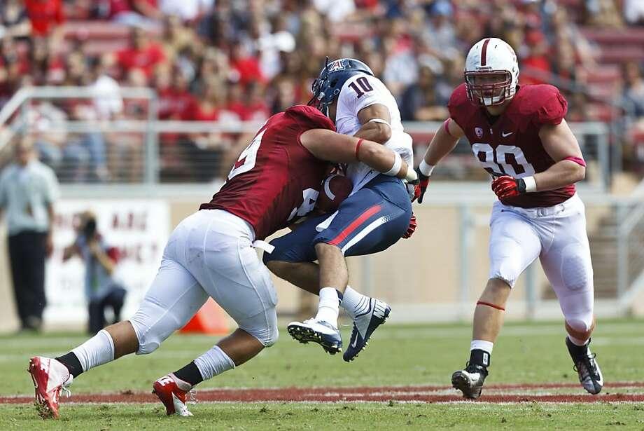 Ben Gardner wraps up Arizona quarterback Matt Scott for one of Gardner's team-leading four sacks this season. Photo: Jason O. Watson, Getty Images