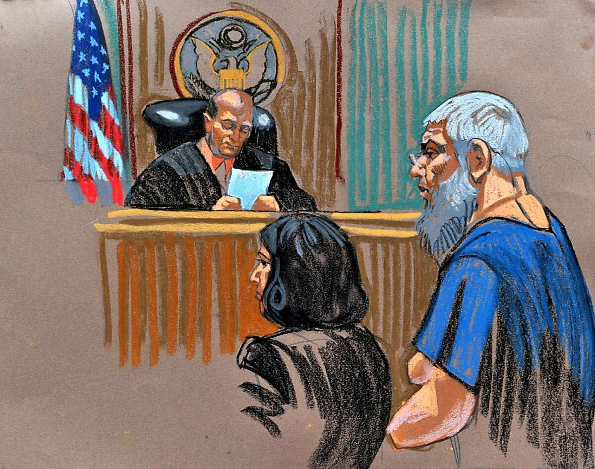 In this courtroom sketch, radical Islamist preacher Abu Hamza al-Masri (R) appears before before US Magistrate Judge Frank Maas (L) in Federal Court on October 6, 2012 in New York after being extradited from Britain. Maas ordered that the Hamza be kept in detention, after a brief court hearing Saturday. The terror suspect was told of the 11 charges he faces. Hamza did not speak at the hearing which was a prelude to his arraignment due October 9, when he will be formally charged. CHRISTINE CORNELL/AFP/GettyImages