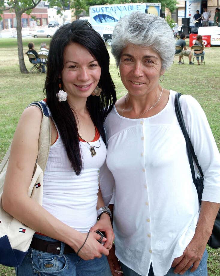 Elizabeth Boites and Esperanza Melendez enjoy Solar Fest at Maverick Park on May 2, 2009. Photo: San Antonio Express-News File Photo / Robert McLeroy