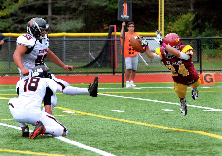 Boys football action between St. Joseph and Stamford in Trumbull, Conn. on Saturday October 6, 2012. Photo: Christian Abraham / Connecticut Post