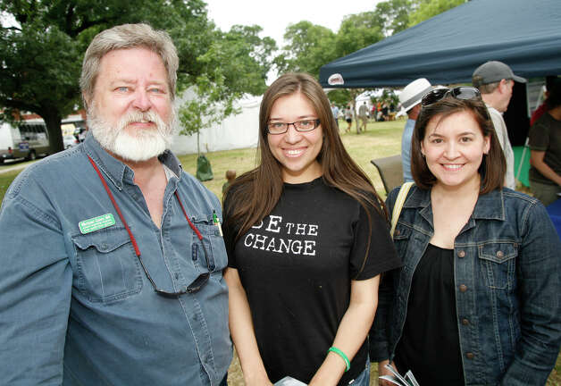 Michael Goins, Citlalli Castellon and Isabel North enjoy Solar Fest on May 1, 2010, at Maverick Park. Photo: J. Michael Short, For The Express-News / THE SAN ANTONIO EXPRESS-NEWS
