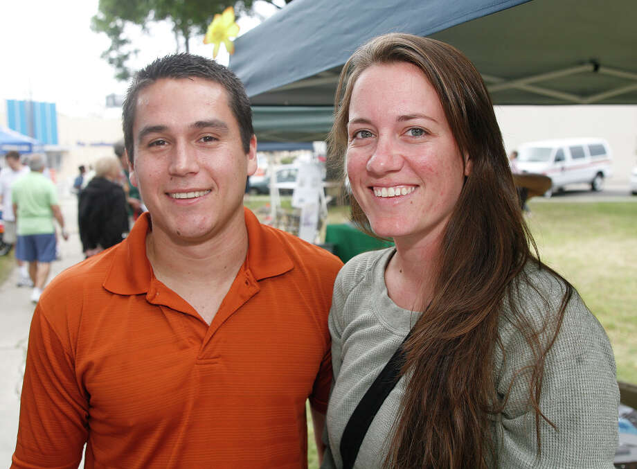 Phill Gonzalez and Chrissy Smith enoy Solar Fest on May 1, 2010, at Maverick Park. Photo: J. Michael Short, For The Express-News / THE SAN ANTONIO EXPRESS-NEWS