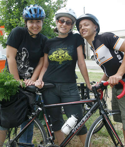 Samantha Wiblitzhouser, April Biasiolli and Timothy Hayes enjoy Solar Fest on May 1, 2010, at Maverick Park. Photo: J. Michael Short, For The Express-News / THE SAN ANTONIO EXPRESS-NEWS