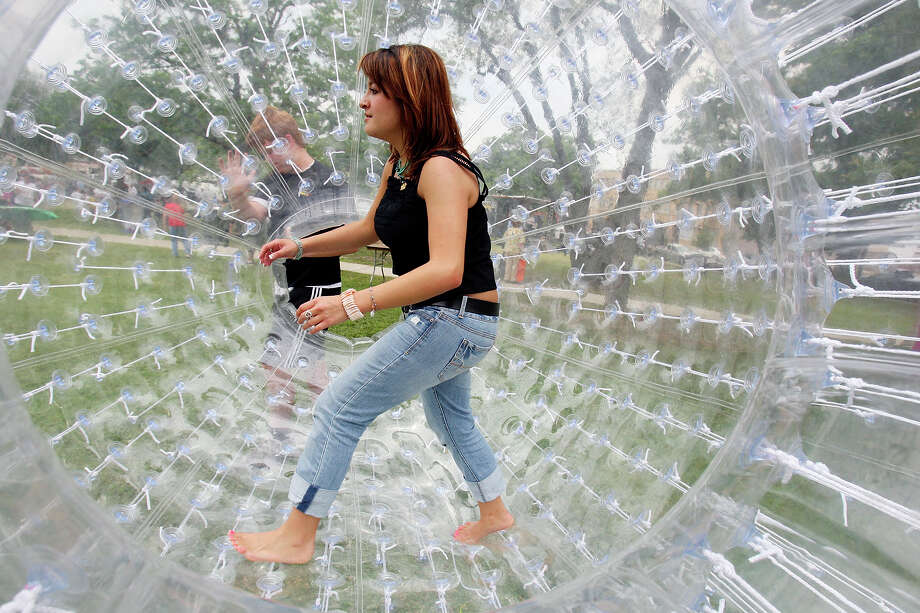 Mica Sosa plays in an inflatable hamster ball while attending Solar Fest on May 2, 2009, at Maverick Park. Photo: Edward A. Ornelas, San Antonio Express-News / eaornelas@express-news.net