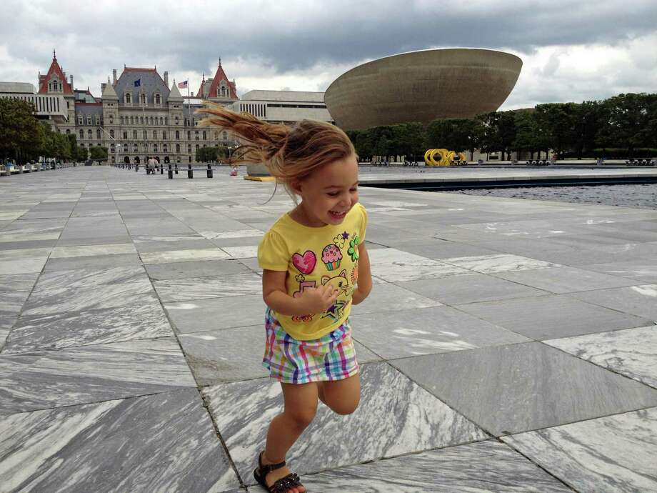 Lawrence Bizzarro snapped this photo of his three-year-old daughter Maria running around the Empire State Plaza just hours before the Sept. 8 storm that caused the cancellation of the Local Legends concert. (Lawrence Bizzarro)