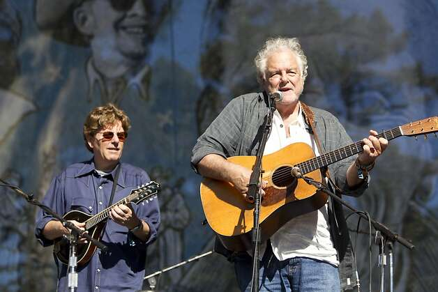Tim O'Brien (left) and Peter Rowan play during a tribute performance honoring Warren Hellman, Earl Scruggs and Doc Watson on the Banjo Stage at Hardly Strictly Bluegrass in Golden Gate Park in San Francisco, Calf., on Saturday, October 6, 2012. Photo: Laura Morton, Special To The Chronicle
