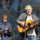 Tim O'Brien (left) and Peter Rowan play during a tribute performance honoring Warren Hellman, Earl Scruggs and Doc Watson on the Banjo Stage at Hardly Strictly Bluegrass in Golden Gate Park in San Francisco, Calf., on Saturday, October 6, 2012.