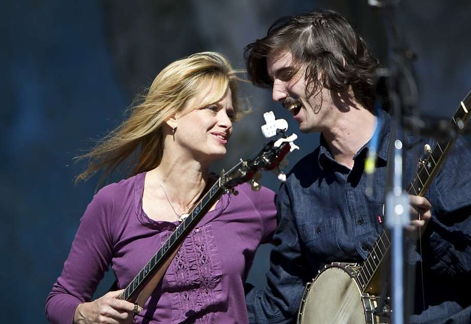 Alison Brown gives Warren Hellman's grandson Matt Gibbs a hug after he played on the Banjo Stage during a tribute to Hellman, Earl Scruggs and Doc Watson at Hardly Strictly Bluegrass in Golden Gate Park in San Francisco, Calf., on Saturday, October 6, 2012. Photo: Laura Morton, Special To The Chronicle