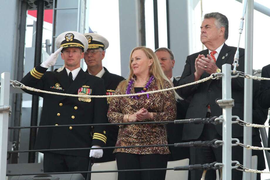 U.S. Navy Commander Thomas Shultz, USS Michael Murphy commanding officer, left, Maureen Murphy, mother of Navy SEAL Lt. Michael P. Murphy, foreground center, Congressman Peter King, right and others take part in the commissioning ceremony for the Navy's newest guided-missile destroyer, the USS Michael Murphy, Saturday Oct. 6, 2012 in New York.  The ship honors Maureen's son, Navy SEAL Lt. Michael P. Murphy, a Long Island native, who became the first American awarded the Medal of Honor during the Afghanistan War when he was killed during an ambush in 2005. Photo: Tina Fineberg, Associated Press / FR73987 AP
