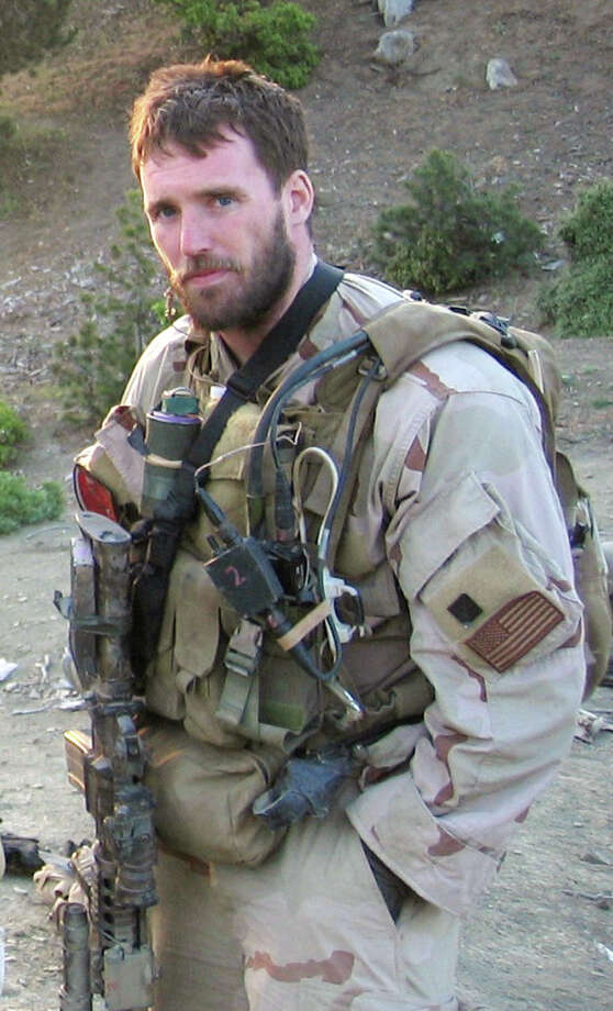 In this undated photo provided by the United States Navy, SEAL Lt. Michael P. Murphy of Patchogue, N.Y., is shown while deployed in Asadabad, Afghanistan. Murphy, who was killed in action while leading a team of SEALs in Afghanistan in 2005, will have a guided missile destroyer commissioned in his name at a ceremony scheduled for Saturday, Oct. 6, 2012 in New York. Photo: Associated Press / U.S. Navy
