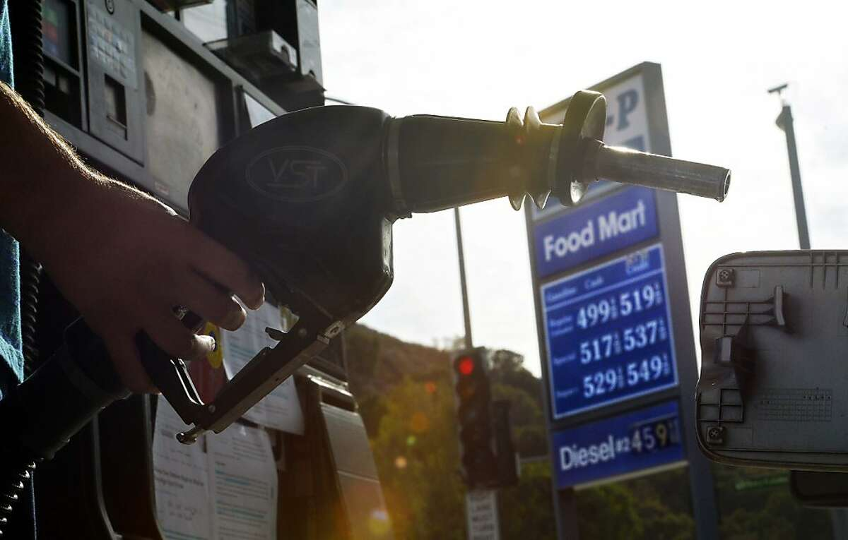 A motorist gases up at a station in the Calabasas area of Los Angeles Saturday, Oct. 6, 2012. The price of gasoline hit an all-time average high in California of $4.6140 a gallon Saturday, fueled by a reduced supply and a volatile market. (AP Photo/Mark J. Terrill)