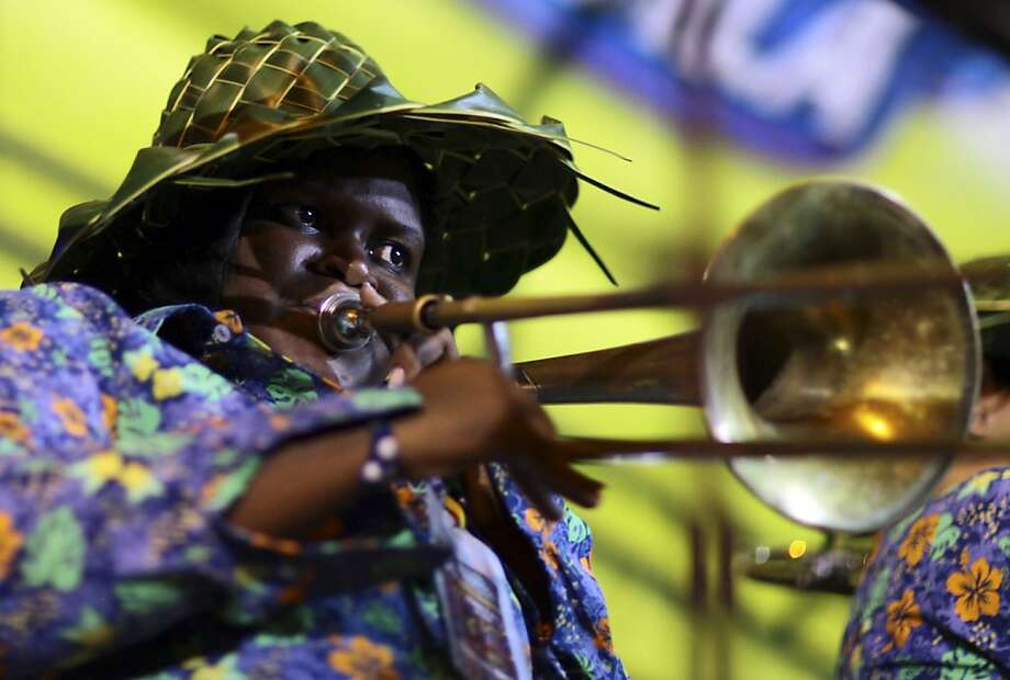 A trombone player with the San Andres band performs during the National Band Festival in Paipa, Colombia, Saturday, Oct. 6, 2012. Every year, Paipa hosts the nationwide competition for professional brass bands. (AP Photo/William Fernando Martinez) Photo: William Fernando Martinez, Associated Press