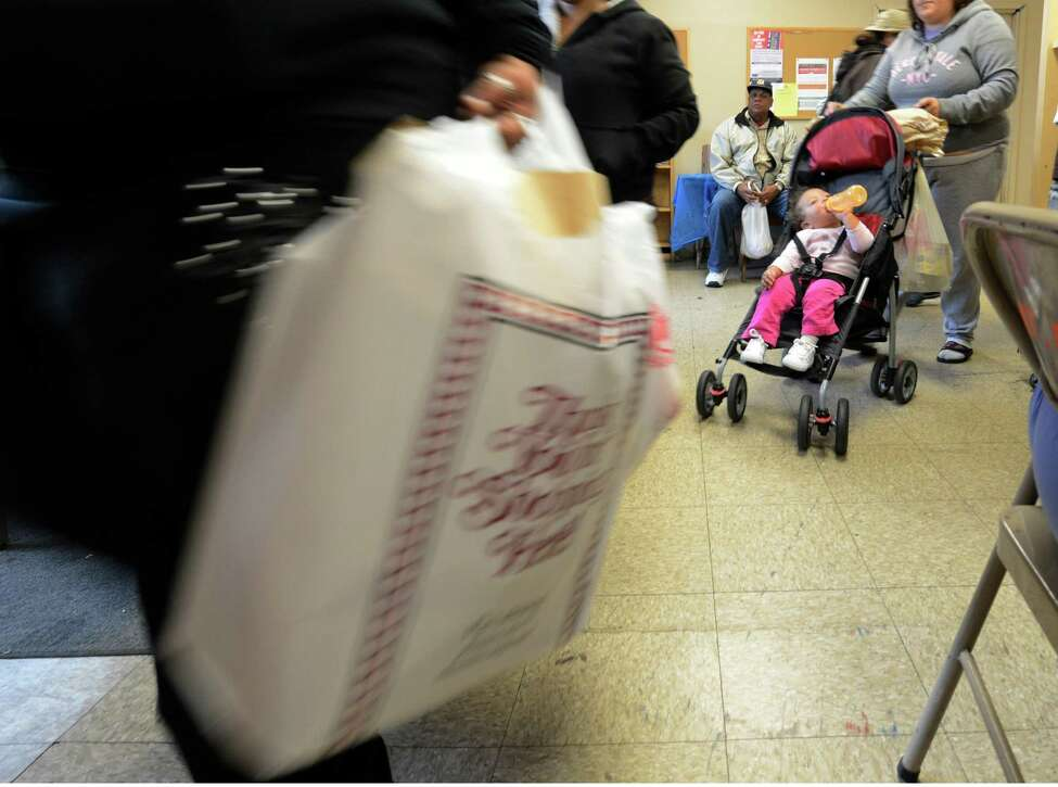 Eleven month old Evelis Sanchez in his stroller leaves after his mother received food at the Schenectady Inner City Mission in Schenectady, N.Y. Sept. 26, 2012. (Skip Dickstein/Times Union)