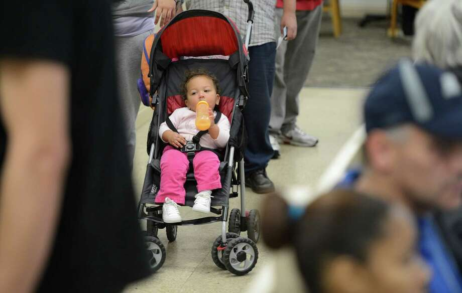 The presidential election has ignored the fate of children such as  Evelis Sanchez, shown waiting for food with his mother last month at the Schenectady Inner City Mission in Schenectady. (Skip Dickstein/Times Union) Photo: Skip Dickstein