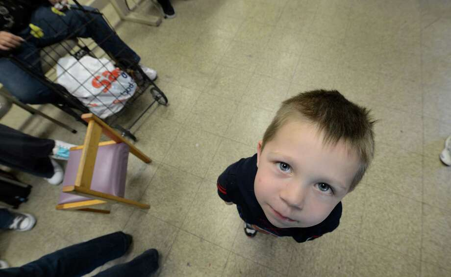 Braydin Holzschuh, 3,  waits with his mother Amanda Seyboth for her food at the Schenectady Inner City Mission in Schenectady, N.Y. Sept. 26, 2012.    (Skip Dickstein/Times Union) Photo: Skip Dickstein
