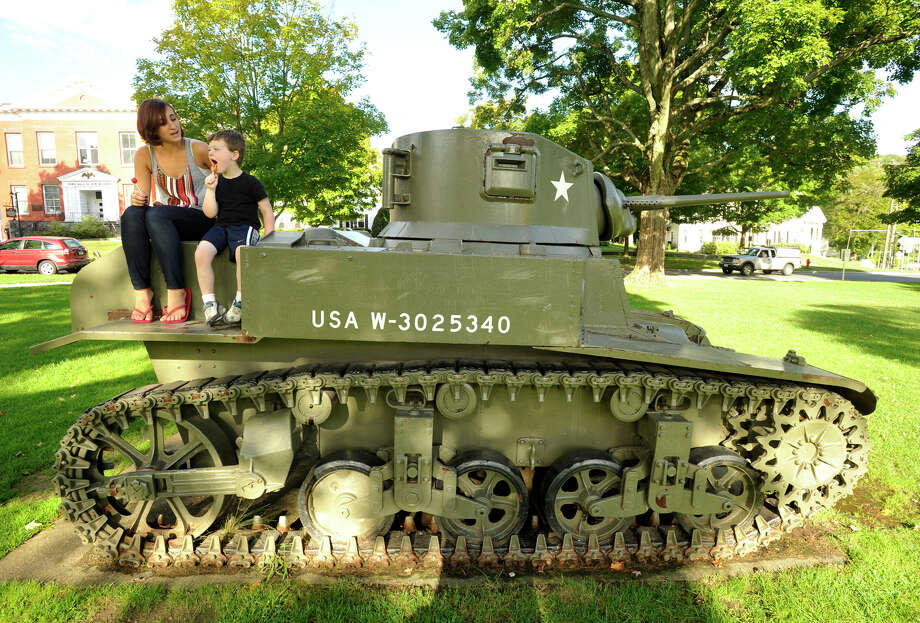 Megan McSherry sits with her son, Ethan, 4, on top of the World War II era tank on the New Milford Green on Wednesday, Sept. 5, 2012. McSherry was a high school student when she found out she was pregnant with Ethan. She has since graduated from high school and works full time while attending Western Connecticut State University. Photo: Jason Rearick / The News-Times