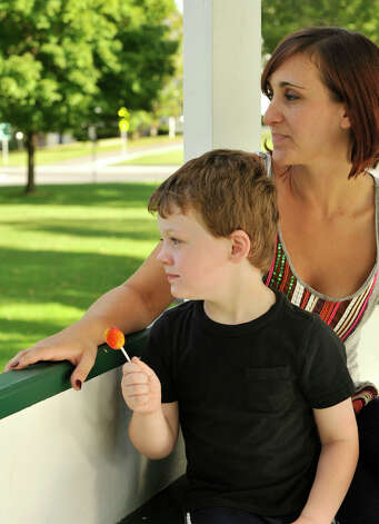 Megan McSherry and her son, Ethan, sit in the gazebo on the New Milford Green on Wednesday, Sept. 5, 2012. McSherry was a high school student when she found out she was pregnant with Ethan. She has since graduated from high school and works full time while attending Western Connecticut State University. Photo: Jason Rearick / The News-Times