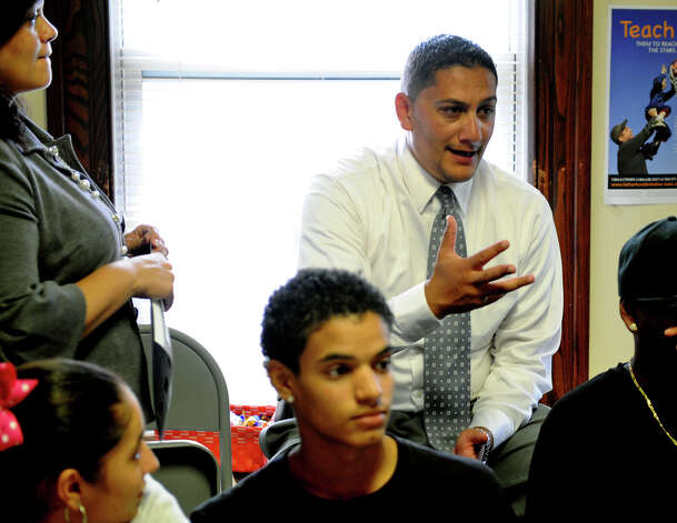 Saleh Hanaif, who heads the Teen Fathers Program, a Connecticut state certified program, meets with teens to talk about teen pregnancy, safe sexual practices and parenthood at the offices of the Greater Bridgeport Adolecent Pregnancy Program on Mill Hill Avenue in Bridgeport, Conn. on Tuesday September 18, 2012. Photo: Christian Abraham / Connecticut Post
