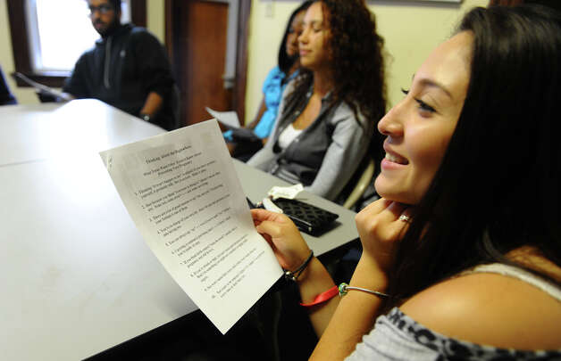 Carolina Rivera, a student at Harding High School, takes part in the Greater Bridgeport Adolecent Pregnancy Program on Mill Hill Avenue in Bridgeport, Conn. on Tuesday September 18, 2012. With instruction from Yanira Diaz-Olivares, a human sexuality counselor with Greater Bridgeport Adolecent Pregnancy Program and Saleh Hanaif, who heads the Teen Fathers Program, teens learn about teen pregnancy, safe sexual practices and coping with parenthood. Photo: Christian Abraham / Connecticut Post
