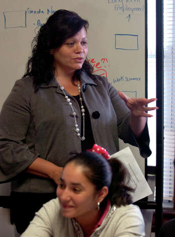 Yanira Diaz-Olivares, left, a human sexuality counselor with Greater Bridgeport Adolecent Pregnancy Program talks to teens about teen pregnancy, safe sexual practices and parenthood at the program's office on Mill Hill Avenue in Bridgeport, Conn. on Tuesday September 18, 2012. Photo: Christian Abraham / Connecticut Post