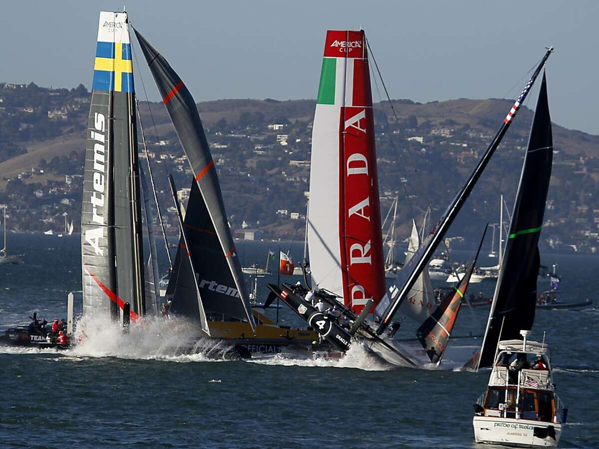 Oracle Team USA Spithill (right) capsizes in the first fleet race of the America's Cup World Series in San Francisco, Calif. on Saturday, Oct. 6, 2012.