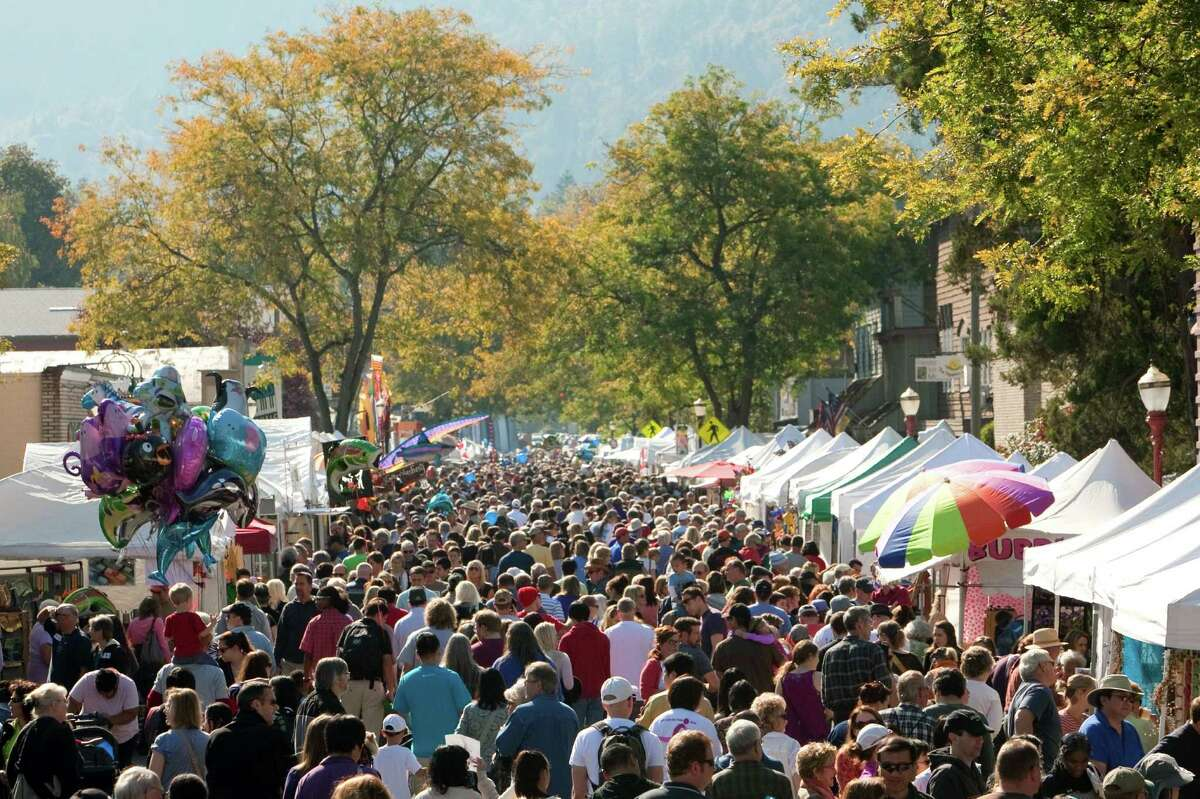 People crowd onto Front Street during Issaquah Salmon Days on Saturday, October 6, 2012. The annual festival kicks off with a parade and celebrates the return of the salmon to Issaquah Creek.