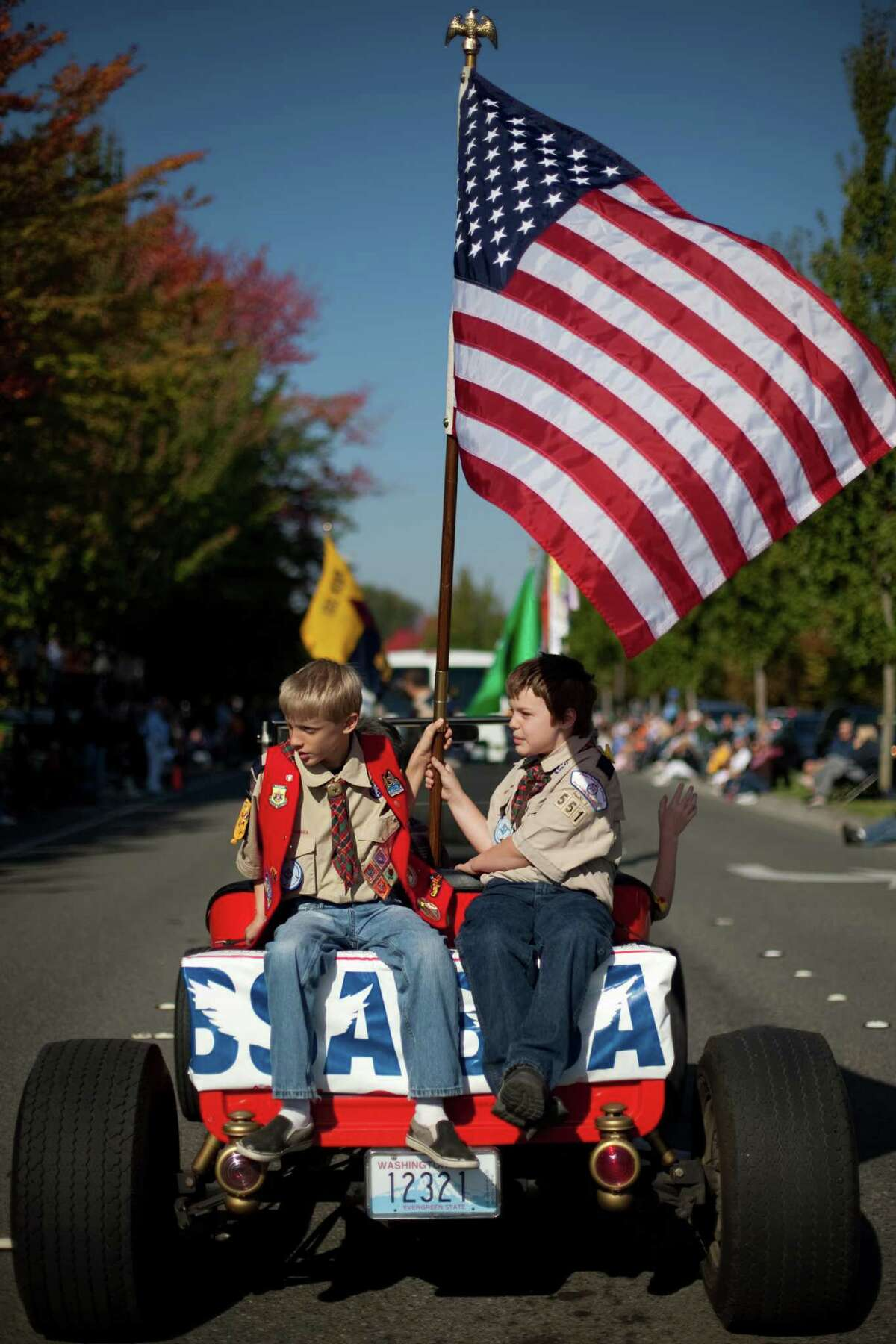 Boy Scouts Jacob Monaghan, 11, left, and Max Eberhardt, 10, ride on the back of a modified 1922 Model T during the Issaquah Salmon Days Parade on Saturday, October 6, 2012. The annual festival kicks off with a parade and celebrates the return of the salmon to Issaquah Creek.
