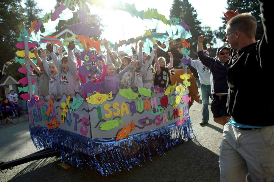 Y-Princesses do the YMCA dance with their dads as the participate in the Issaquah Salmon Days Parade on Saturday, October 6, 2012. The annual festival kicks off with a parade and celebrates the return of the salmon to Issaquah Creek. Photo: JOSHUA TRUJILLO / SEATTLEPI.COM
