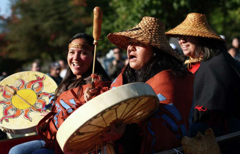 Native drummers perform during the Issaquah Salmon Days Parade on Saturday, October 6, 2012. The annual festival kicks off with a parade and celebrates the return of the salmon to Issaquah Creek. Photo: JOSHUA TRUJILLO / SEATTLEPI.COM