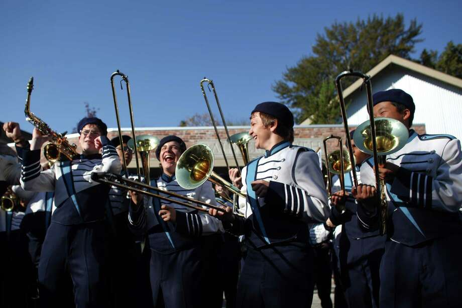 Members of the Interlake High School marching band have some fun before marching in the Issaquah Salmon Days Parade on Saturday, October 6, 2012. The annual festival kicks off with a parade and celebrates the return of the salmon to Issaquah Creek. Photo: JOSHUA TRUJILLO / SEATTLEPI.COM