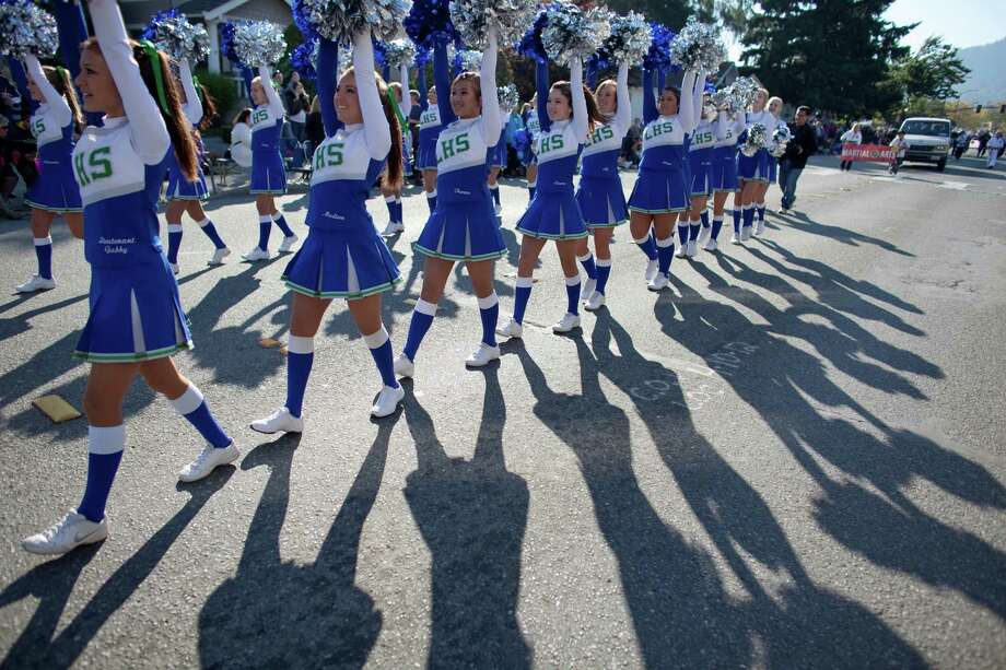 The Liberty High School cheer squad participates in the Issaquah Salmon Days Parade on Saturday, October 6, 2012. The annual festival kicks off with a parade and celebrates the return of the salmon to Issaquah Creek. Photo: JOSHUA TRUJILLO / SEATTLEPI.COM