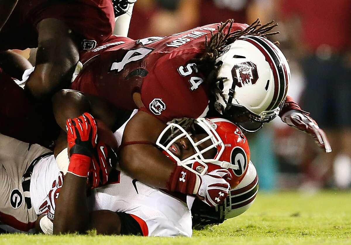 COLUMBIA, SC - OCTOBER 06: Shaq Wilson #54 of the South Carolina Gamecocks tackles Keith Marshall #4 of the Georgia Bulldogs at Williams-Brice Stadium on October 6, 2012 in Columbia, South Carolina. (Photo by Kevin C. Cox/Getty Images)